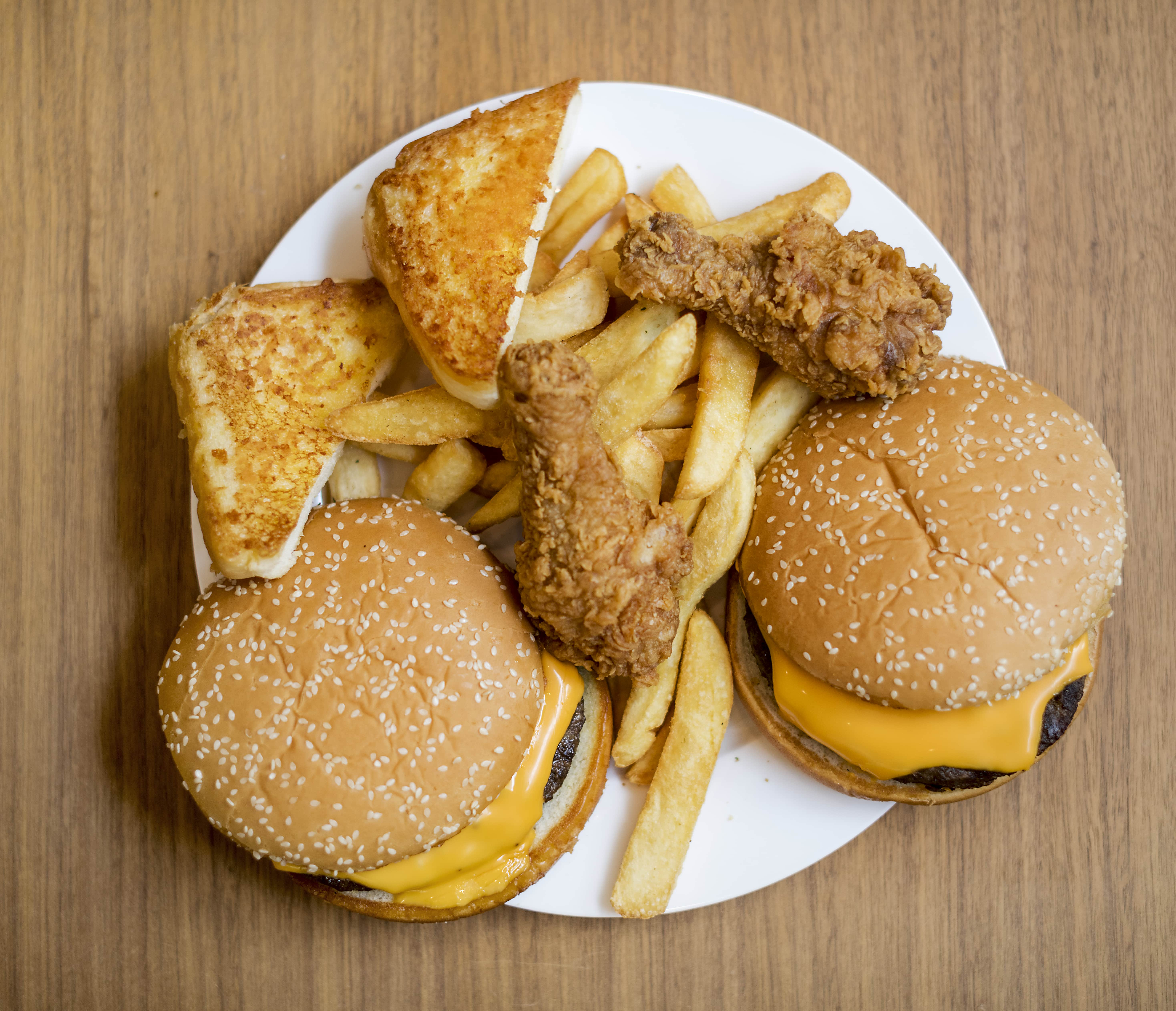 A plate full of fast food that would not help a trucker establish a healthy lifestyle